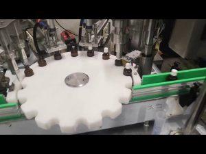 mali stroj za punjenje tekućine u boce